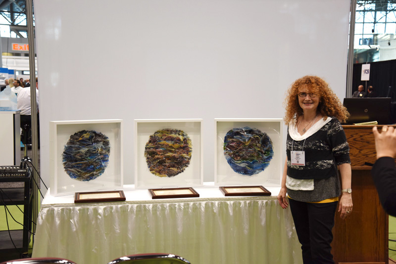The Brooklyn-based artist Etty Yaniv with the artworks she created for the winners.