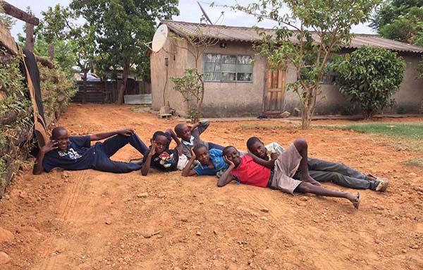 Boys lying on road smaller 2